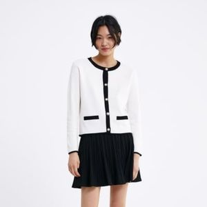 White Cardigan with Pearl Buttons and Black Trim